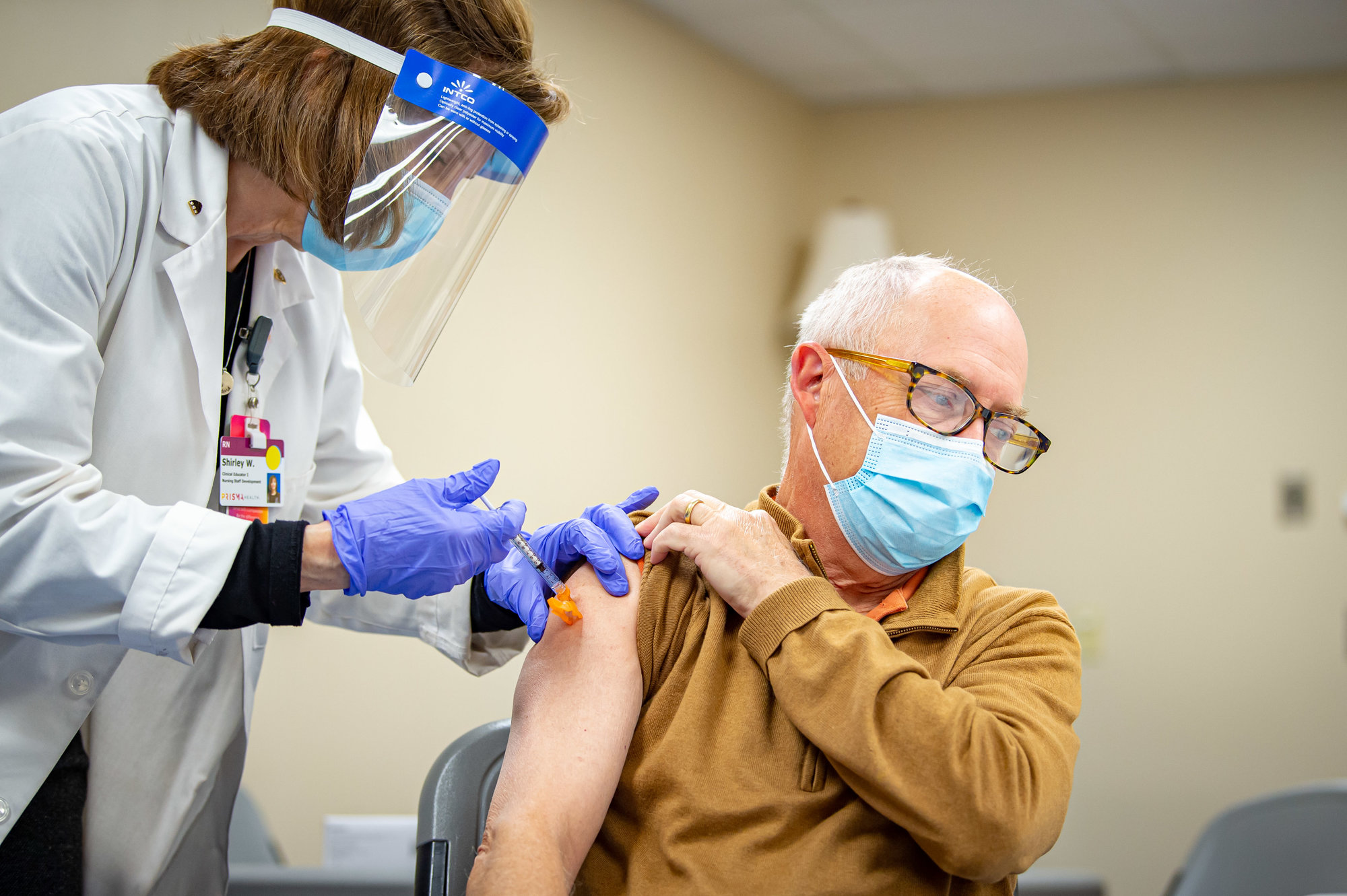 Dr. Gene Dickerson, a surgeon at Prisma Health Tuomey Hospital and currently the hospital's chief medical officer, receives his first Pfizer COVID-19 vaccine shot on Dec. 23, 2020.