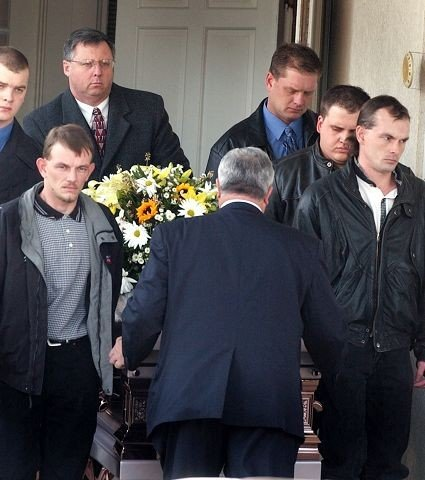 Family and friends of Bobbie Jo Stinnett gather for her burial near Skidmore, Missouri, on Dec. 21, 2004. Stinnett, a young pregnant woman, was strangled, and her baby girl was cut from her womb. Lisa M. Montgomery, 36, of Melvern, Kansas, was convicted in her killing. She was executed Wednesday, Jan. 13, 2021.