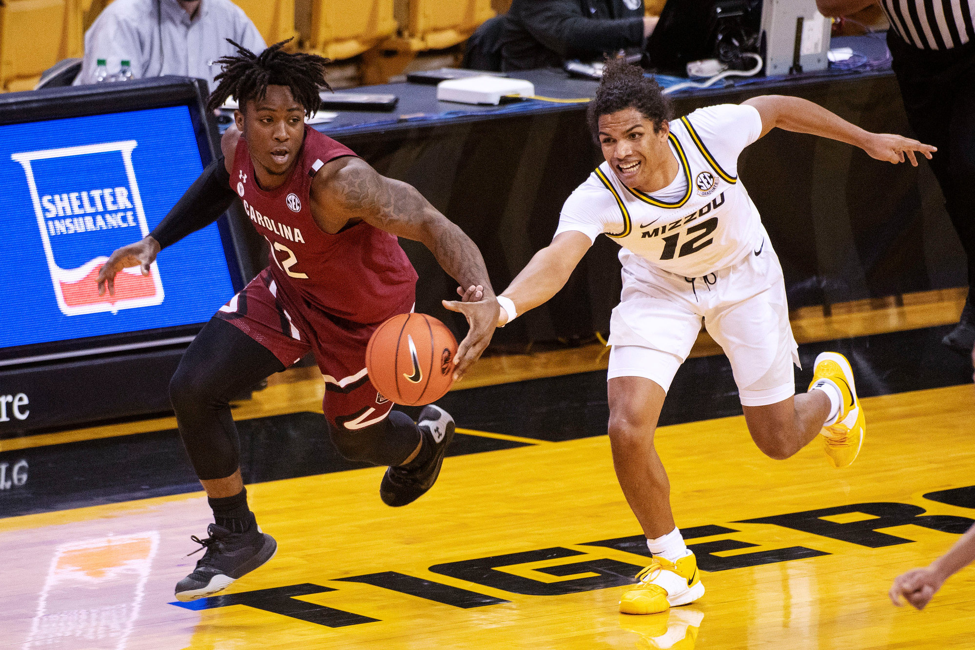 South Carolina's Trae Hannibal, left, and Missouri's Dru Smith, right, battle for a loose ball during the the Gamecocks' 81-70 loss on Tuesday in Columbia, Missouri.