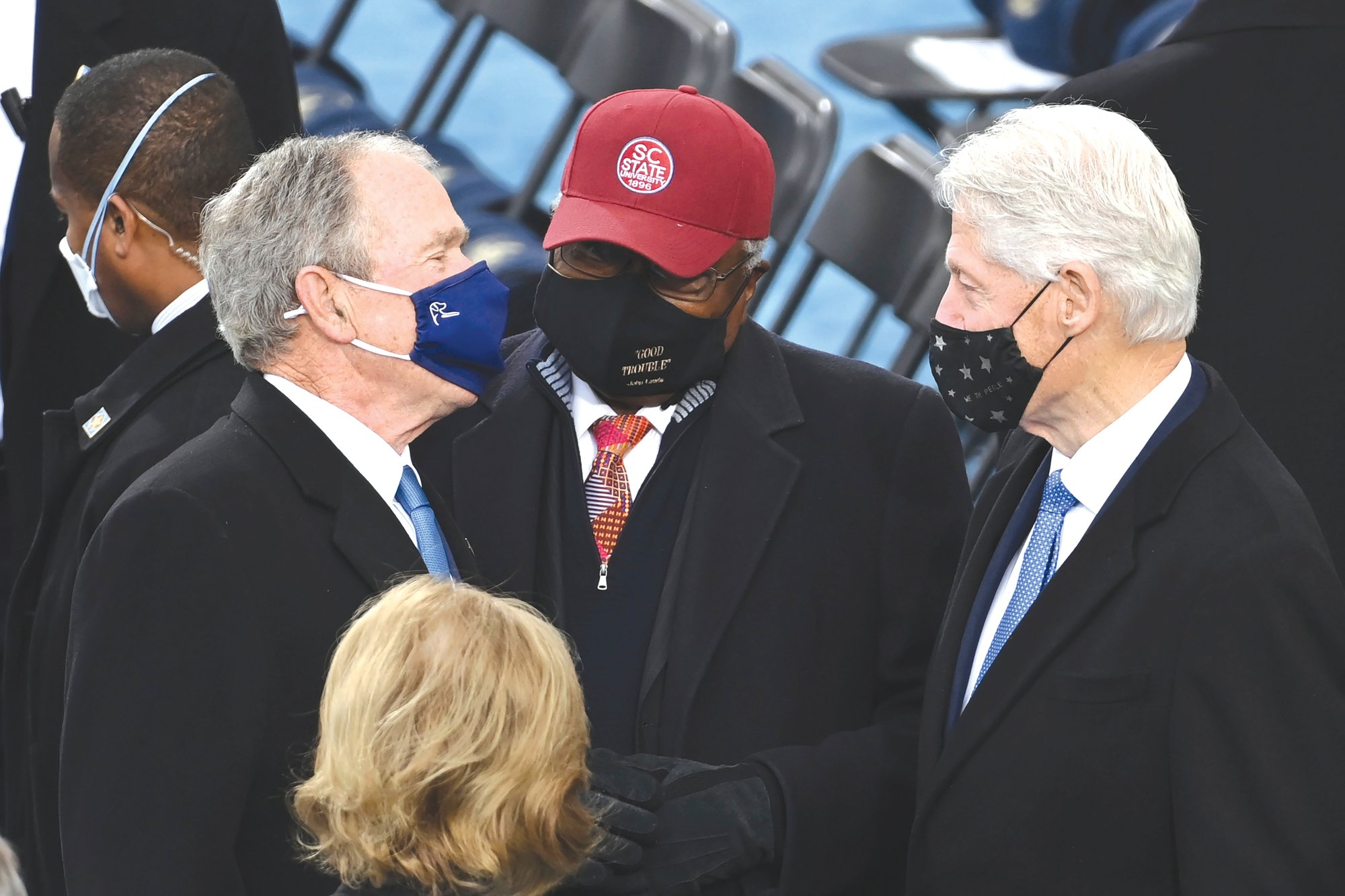 Former President George W. Bush; House Majority Whip Jim Clyburn, D-S.C. and native of Sumter; and former President Bill Clinton  are seen ahead of President-elect Joe Biden's inauguration ceremony Wednesday in Washington.