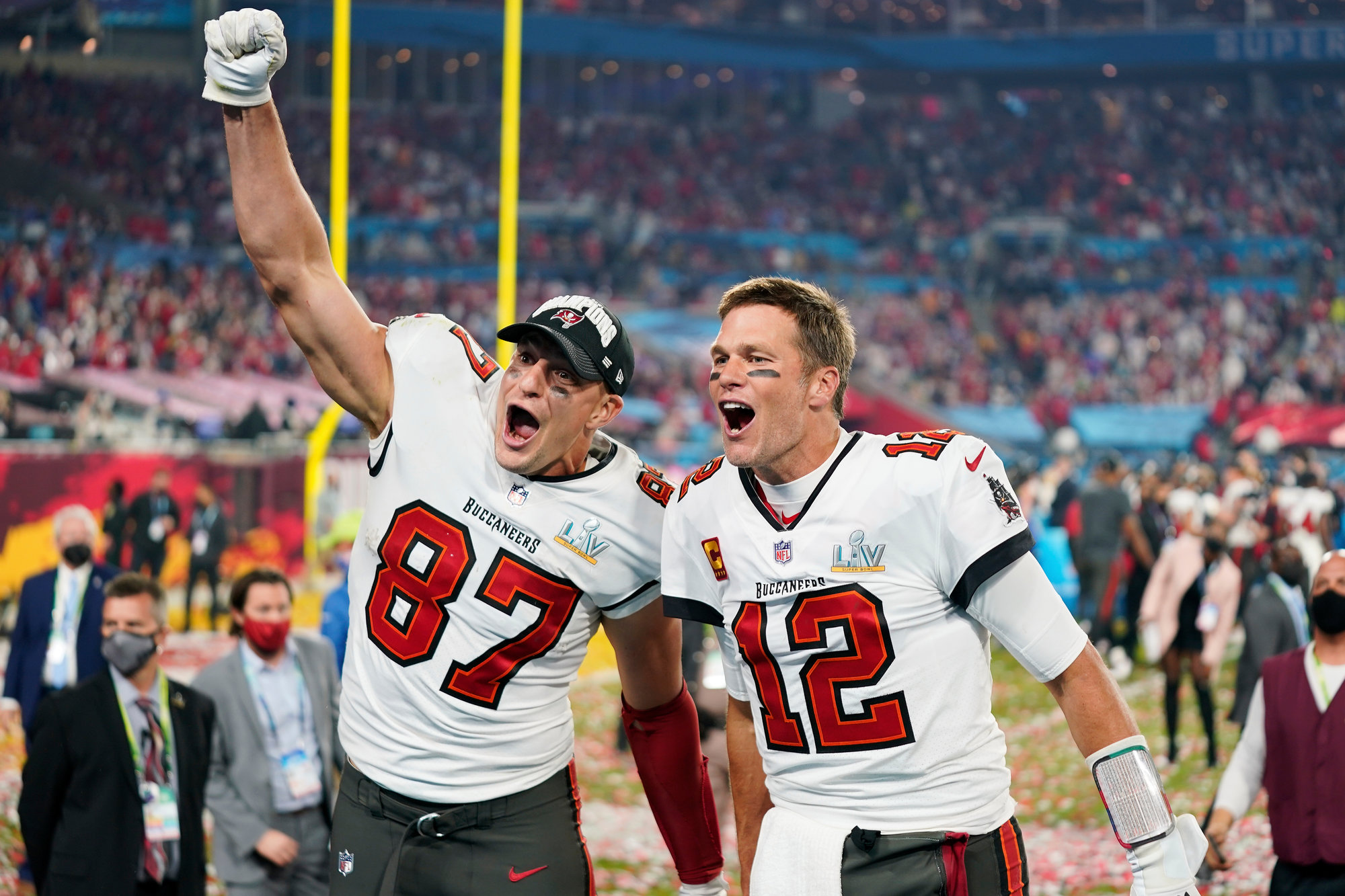 Tampa Bay Buccaneers tight end Rob Gronkowski (87), left, and Tampa Bay Buccaneers quarterback Tom Brady (12) celebrate together after the NFL Super Bowl 55 football game against the Kansas City Chiefs, Sunday, Feb. 7, 2021, in Tampa, Fla. The Tampa Bay Buccaneers defeated the Kansas City Chiefs 31-9.