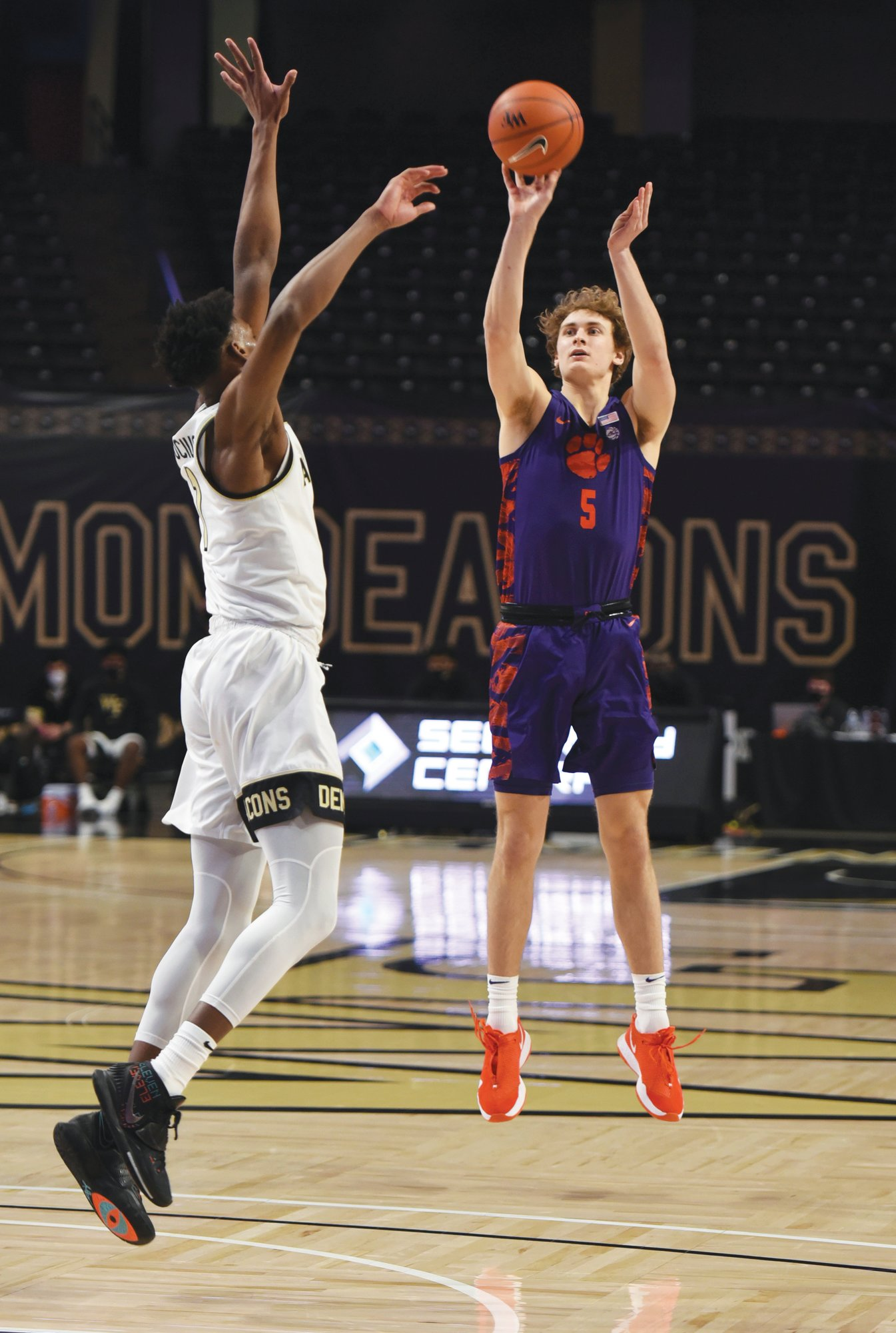Clemson's Hunter Tyson (5) shoots over Wake Forest's Isaiah Mucius during the Tigers' 50-39 win on Wednesday in Winston-Salem, North Carolina.