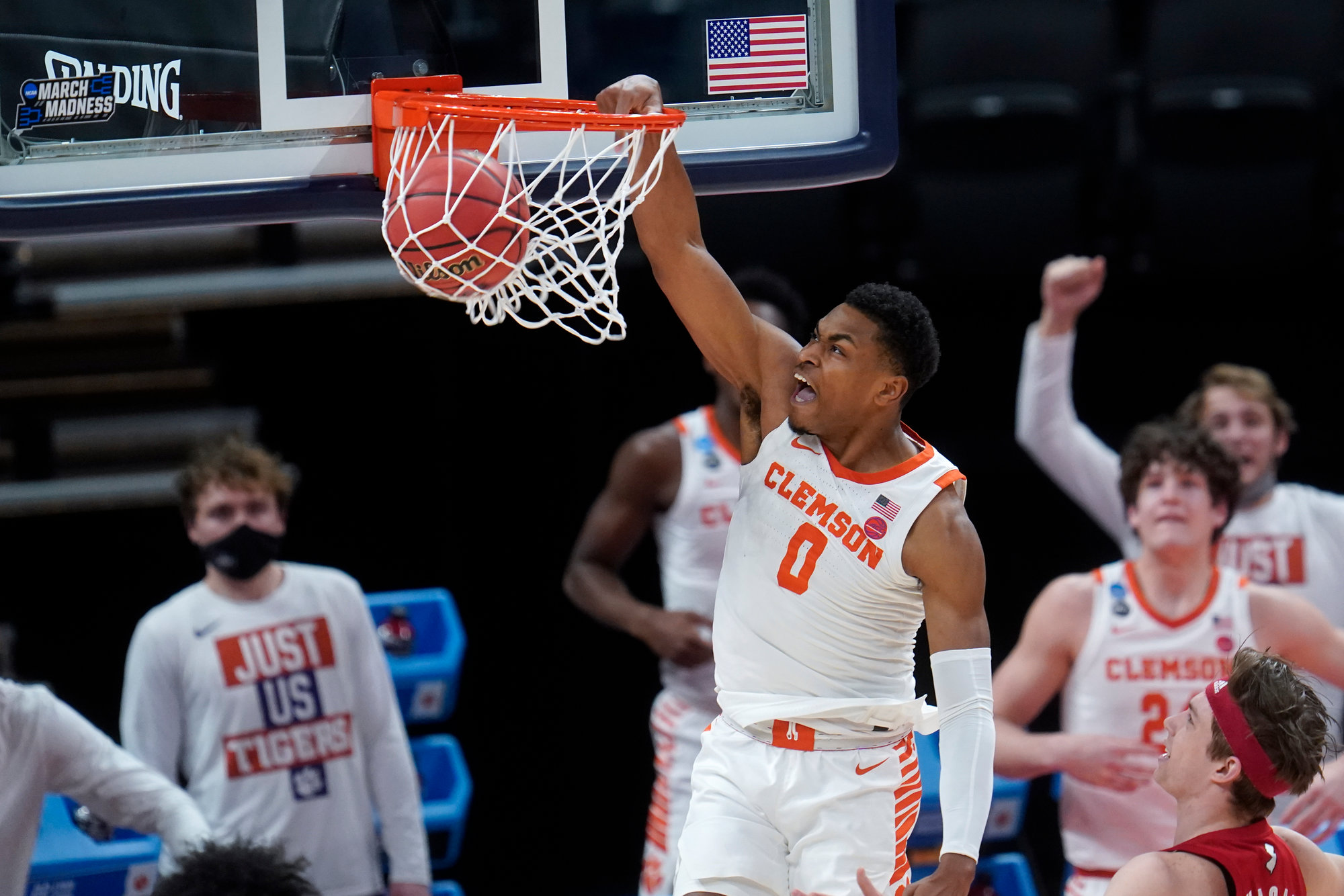 Clemson guard Clyde Trapp (0) dunks during the Tigers' 60-56 loss to Rutgers in the first round of the NCAA Tournament at Bankers Life Fieldhouse in Indianapolis on Friday.