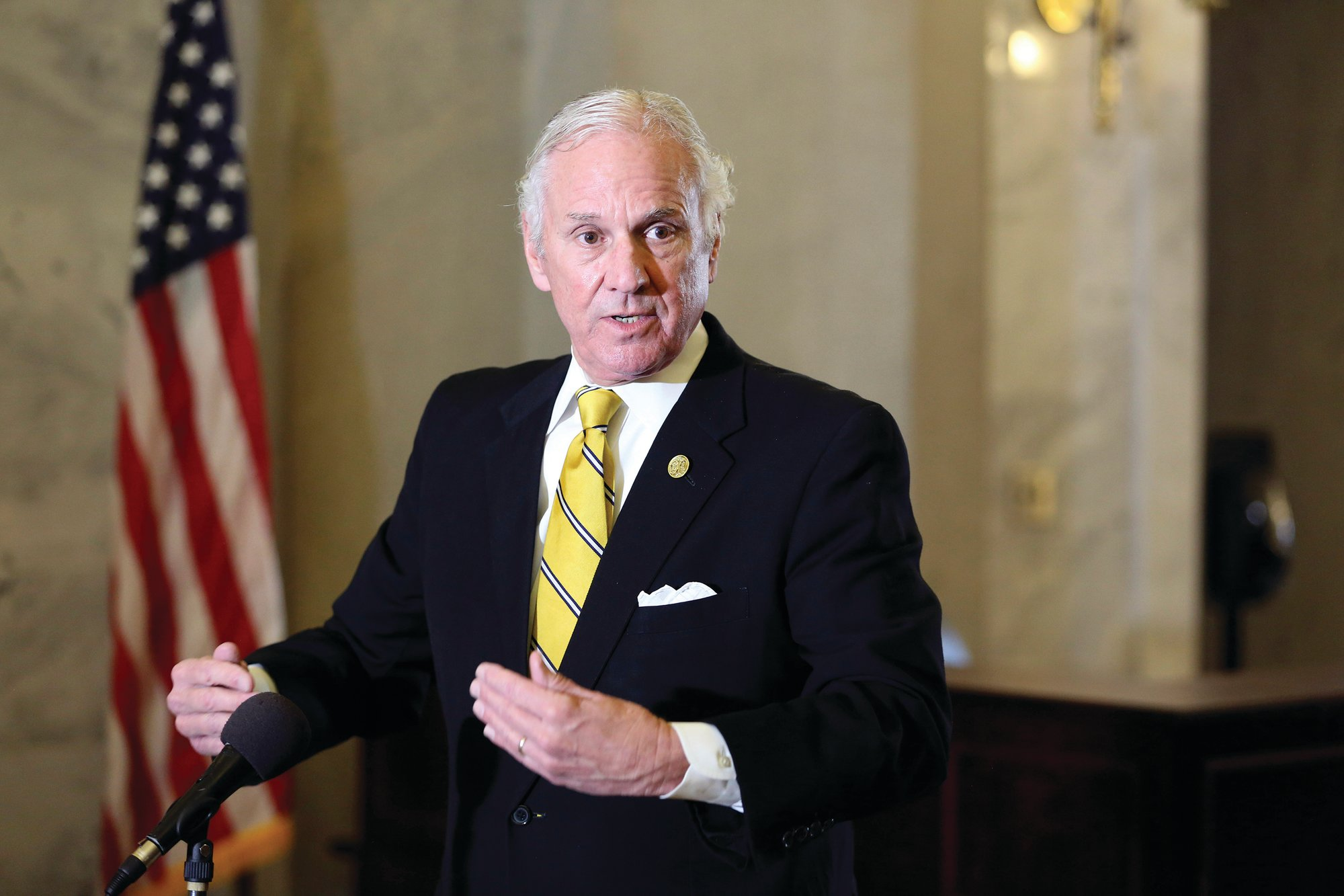 AP FILE PHOTO  South Carolina Gov. Henry McMaster is seen at a January press conference. The American Civil Liberties Union filed a lawsuit against McMaster for requiring state employees to return to their offices during the ongoing pandemic.