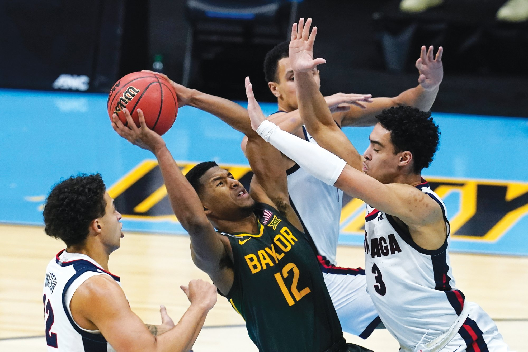 Baylor guard Jared Butler (12) drives into a swarm of Gonzaga defenders during the Bears' 86-70 win in the NCAA national championship game on Monday at Lucas Oil Stadium in Indianapolis.