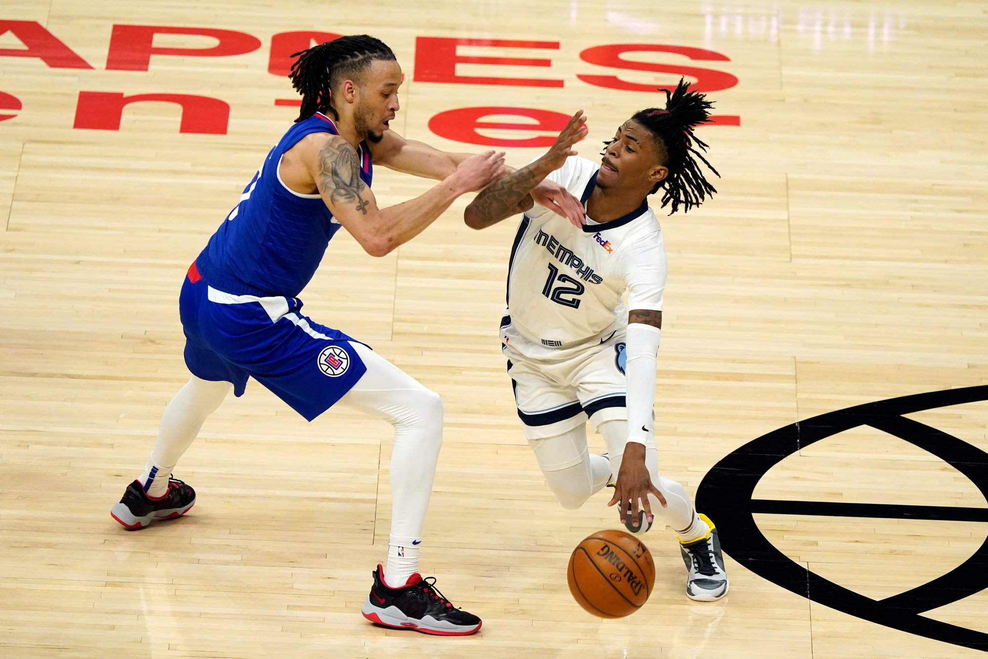 former Crestwood star and current Memphis guard Ja Morant (12) attempts to drive past Los Angeles Clippers guard Amir Coffey during the Grizzlies' 117-105 loss on Wednesday in Los Angeles.