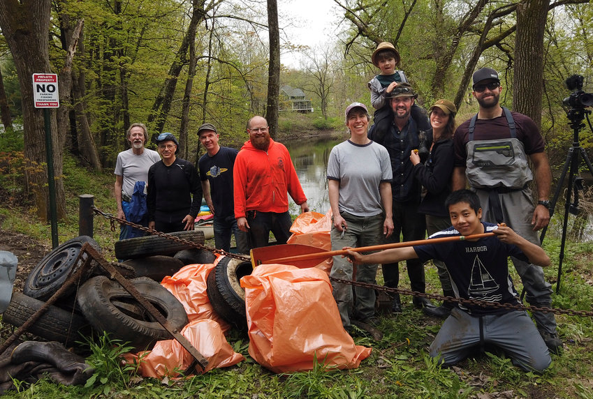 Riversweep volunteers pose with some of the stuff they pulled out of the Rondout Creek.