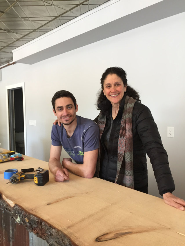 Primo Stropoli and his mother, Joanne Tetta Stropoli, behind an unfinished countertop in the newly renovated Tetta's Market