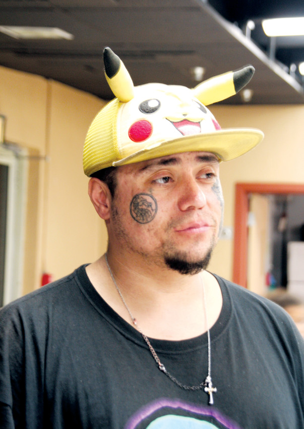 Mitch Pino, 34, wearing his Pikachu hat, was born and raised in Denver and currently lives in a cave in Jefferson County. He stayed at the Westwoods Community Church's Severe Weather Shelter on Jan. 29 and was one of the Jeffco residents facing homelessness counted in the Point-in-Time survey.