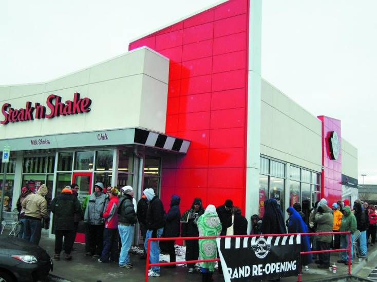 "Several hundred people lined up outside the Cetennial Steak 'n Shake restaurant on a wet, blustery morning Nov. 25. The crowd was hoping to take advantage of the company's offer of ""free Steak 'n Shake for a year"" to the first 100 customers."