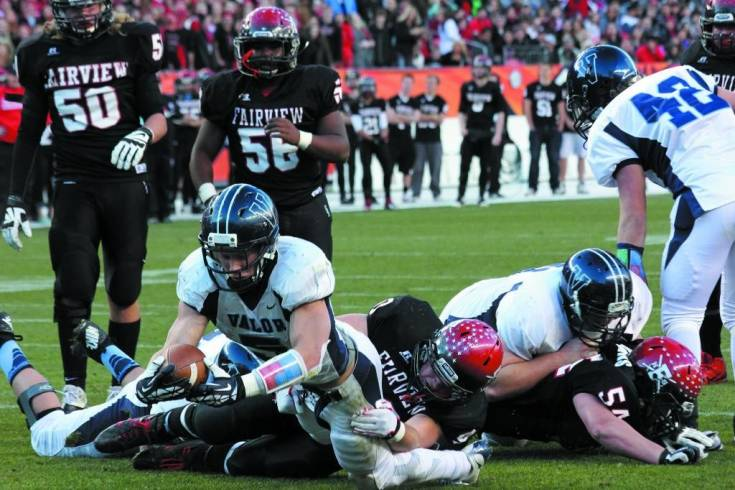 Valor senior Christian McCaffrey (5) dives across the goal line for one of his four touchdowns as the Eagles rolled to a 56-16 win over Fairview in the Nov. 30 Class 5A state championship game at Sports Authority Field at Mile High. McCaffrey was selected as the team's most valuable player.