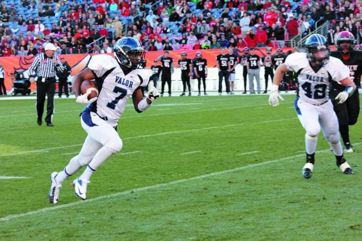 Eric Lee Jr. carries the ball into the endzone for Valor Christian's first touchdown during the Nov. 30 Class 5A state championship football game at Sports Authority Field at Mile High.