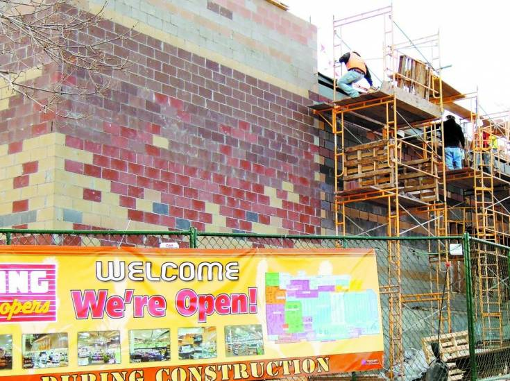 Construction workers do exterior brick work on Dec. 2 on the 18,000-square-foot expansion of the Cherrywood Square King Soopers, located at Dry Creek and Arapahoe roads.