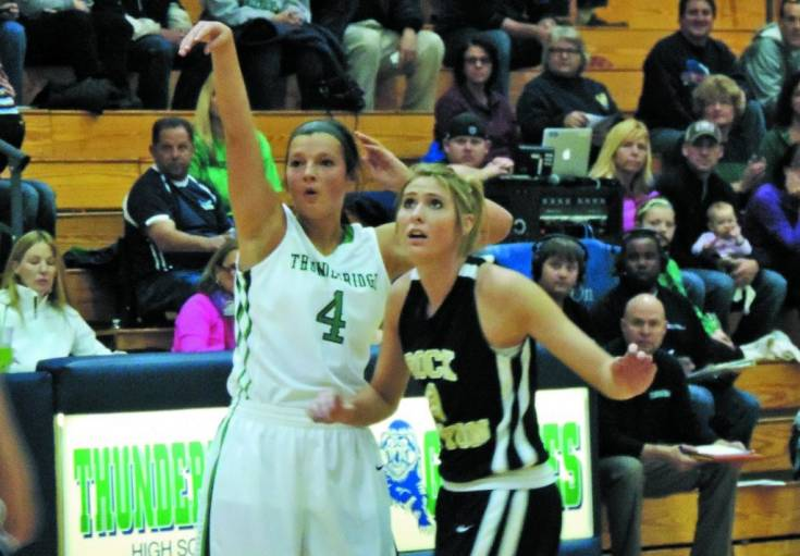 ThunderRidge�s Taylor Rusk shoots over Rock Canyon�s Kendall Koslosky during a Dec. 7 TRHS win.