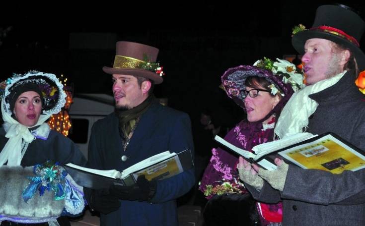 The What the Dickens carolers sang classic Christmas favorites as shoppers strolled through Olde Town Square during Lagniappe, Dec. 3.