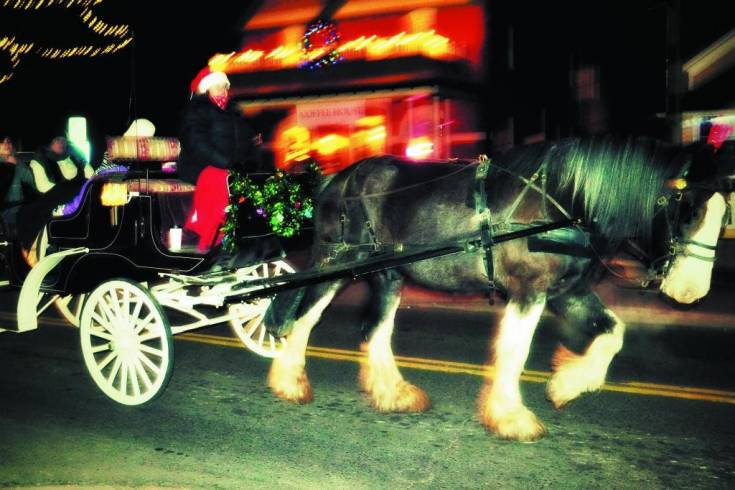 Horse-drawn carriages drove Lagniappe attendees around Olde Town in Christmas style.