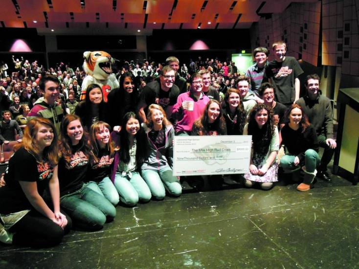"Above, members of the Lakewood High School Student Senate present the Red Cross of Colorado with a check for $9,000. The money was raised through selling the school's ""One World, One Roar"" T-shirts. At left, the Red Cross of Colorado thanked Lakewood High School's seniors for the money raised by the sale of the ""One World, One Roar"" T-shirts. The presentation took place Dec. 3."