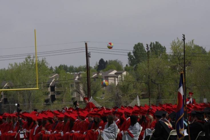 Although it wasn�t on the program, two beach balls suddenly appeared and were batted around by the graduating seniors during the May 18 Heritage High School commencement ceremonies. Photo by Tom Munds