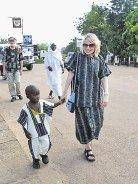 Heritage High School staff member Shelly Harwell walks a child from Kabala, Sierra Leone in West Africa. Harwell was present for the grand opening of Heritage High School of Kabala which Littleton students helped raise over $60,000 for. Courtesy Heritage High School