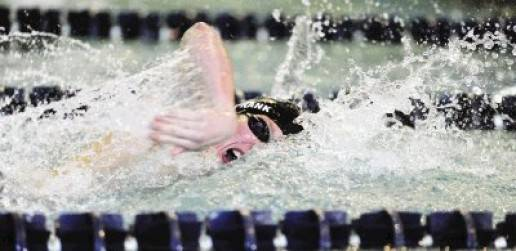 Pine Creek freshman John Frank swims in the 400-yard freestyle relay in a dual meet against Air Academy April 28 at Rampart High School. Frank has already qualified individually for state in the individual medley, backstroke and butterfly. Photo by Kevin Kreck