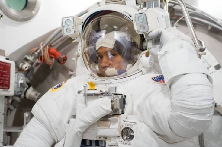 Astronaut Alvin Drew, STS-133 mission specialist, participates in an Extravehicular Mobility Unit space suit fit check in the Space Station Airlock Test Article in the Crew Systems Laboratory at NASA's Johnson Space Center. Courtesy photo | NASA, Mark Sowa