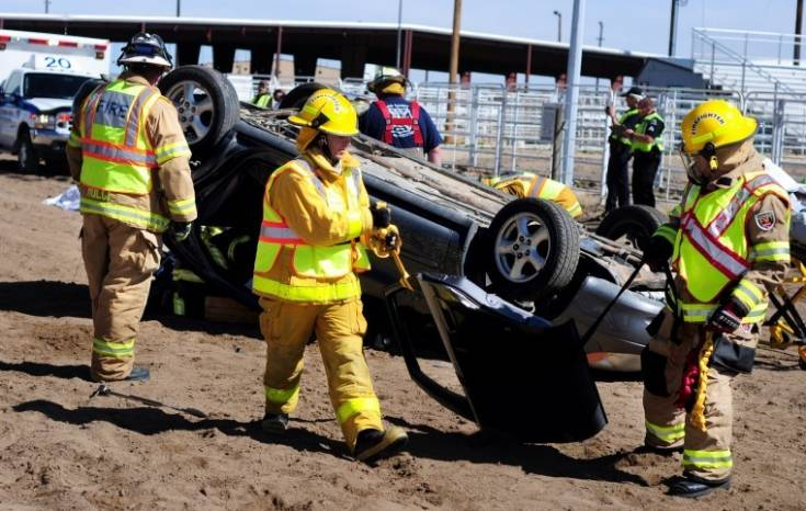 Firefighters pry the car door from a simulated car wreck April 21 at the Elbert County Fairgrounds in Kiowa. High school students from the area watched the mock crash and heard from speakers about the dangers of drunk driving. Photo by Courtney Kuhlen | ckuhlen@ccnewspapers.com