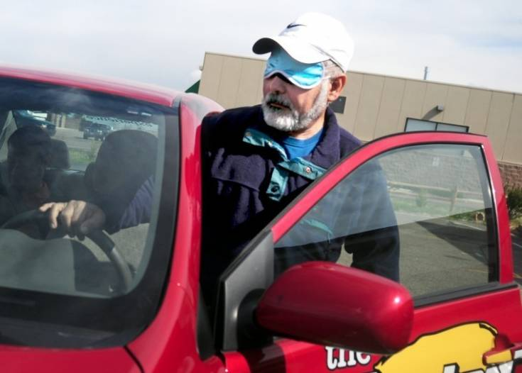 Omar Carreon gets behind the wheel of one of the training cars at Masterdrive. Carreon, who attends the Colorado Center for the Blind, said it had been more than 20 years since he had driven. Photo by Courtney Kuhlen