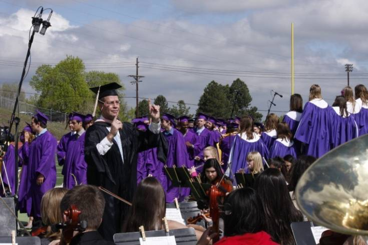 "Don Emmons directs the Littleton High School graduation ensemble as the musicians provide the traditional processional music, �Pomp and Circumstance"" on May 20. Photo by Tom Munds"