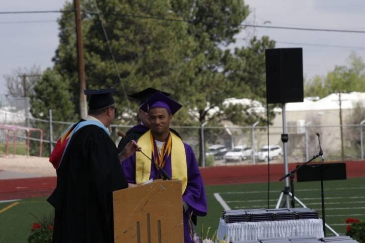Jonathan Edmunds was the first graduate called up to receive his diploma May 20 during Littleton High School commencement ceremonies. Edmunds was given his diploma ahead of fellow students so he could go to Jefferson County Stadium in pursuit of a state championship in the triple jump and high jump. Photo by Tom Munds