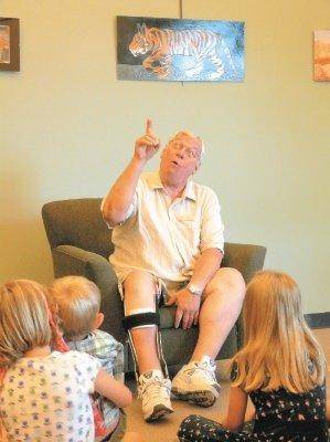 Rick Way, a Spellbinders volunteer for the Douglas County Library District is animated for the children while he tells his story at the Philip S. Miller Library in Castle Rock.