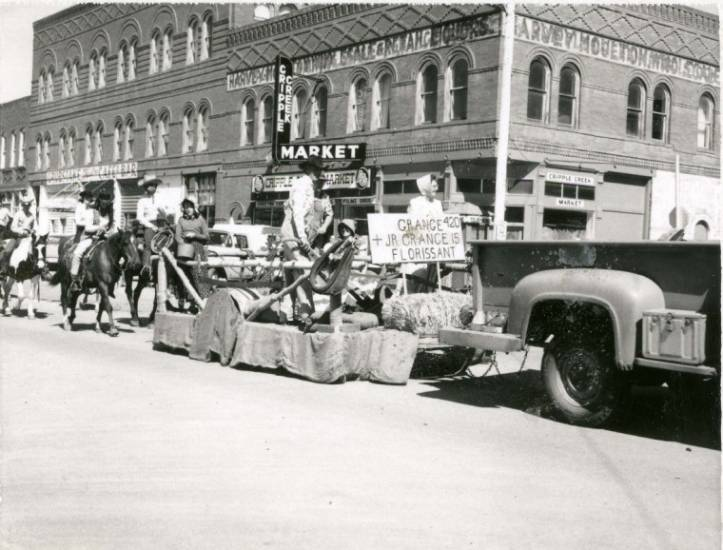The Donkey Derby Days parade marches, rolls and trots past The Welty Block in the early 1970s. The Welty Block burned down on March 4, 1977. Courtesy photo | Cripple Creek District Museum