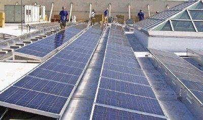 A crew installs solar modules on the Englewood Civic Center roof, one of four city building fitted with the solar systems. Plans are to activate the system by Nov. 1 that will provide about 10 percent of the electricity used in each of the buildings. Photo courtesy of Thames Solar