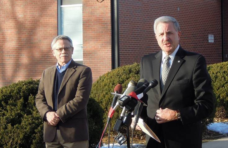 Arapahoe County Sheriff Grayson Robinson, right, updates the media Dec. 14 on the investigation into the previous day's shooting at Arapahoe High School. At left is Littleton Public Schools Superintendent Scott Murphy.