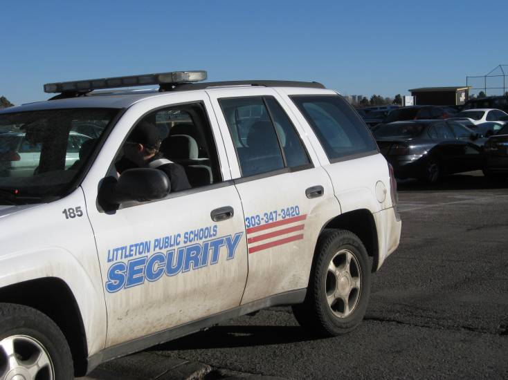 School district security personnel kept watch on Dec. 14 as students came to pick up their cars from the west parking lot at Arapahoe High School.