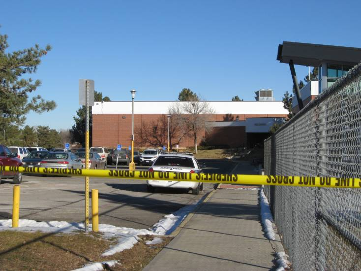 A day after the Dec. 13 shooting at Arapahoe High, the school remained cordoned off with crime-scene tape.