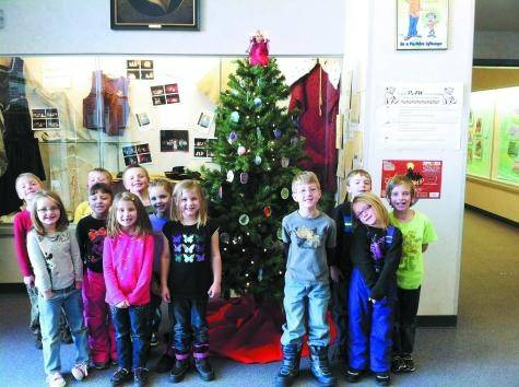 Students at Cresson Elementary School in Cripple Creek celebrated the Christmas season by making tree ornaments from clay. The tree was auctioned at the Aspen Mine Center Dec. 14 and the proceeds donated to the Cripple Creek Care Center.