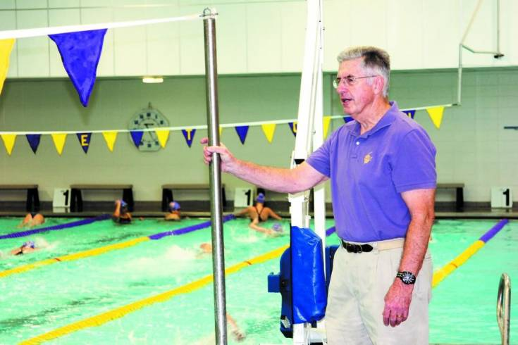 "Coach Maurice ""Stringy"" Ervin calls out the warmup exercises he wants the Littleton High School girls swim team members to follow as they prepare for a Dec. 2 dual meet. Ervin, an LHS graduate, started coaching swimming for the Lions in 1968 and is still at it."