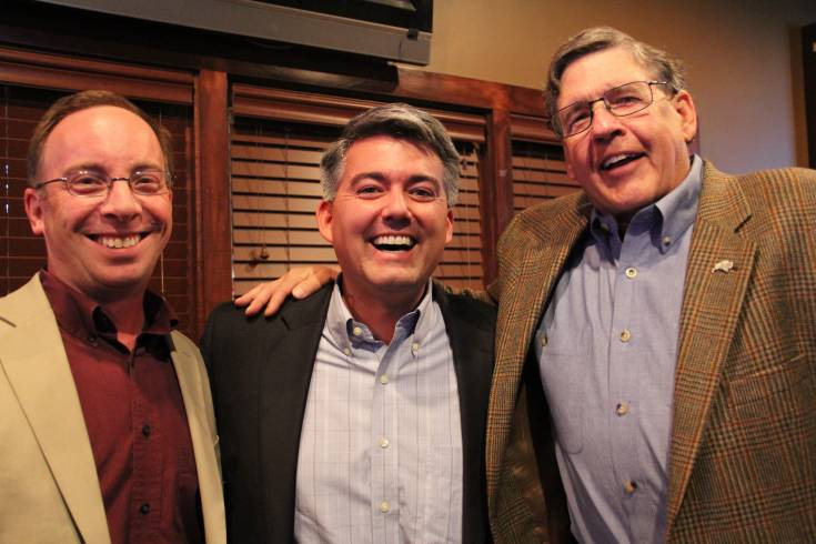 One of the two newest Douglas County school board members, Jim Geddes, right, celebrates his victory with Douglas County Republican Chairman Craig Steiner, left, and U.S. Congressman Cory Gardner (R-District 4) Nov. 5 at the Fowl Line in Castle Rock.