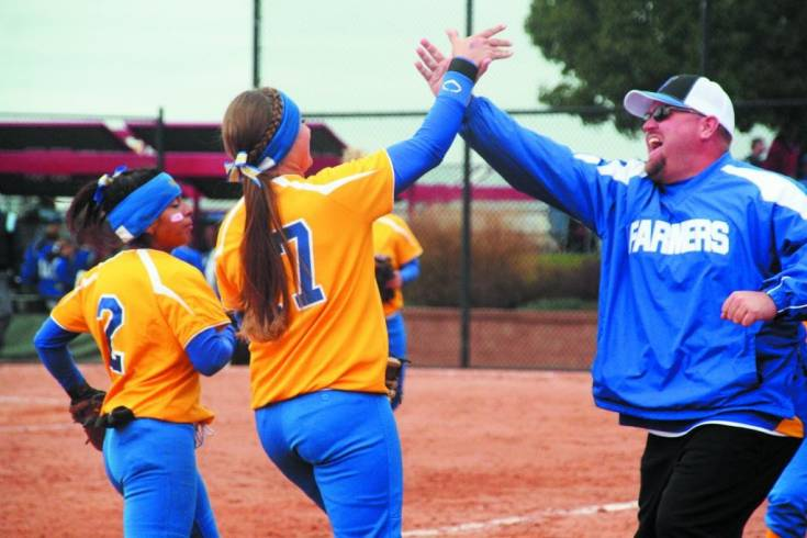 Wheat Ridge slugger Ann Marie Torre and coach Marty Stricklett hi-five after a huge defensive stop against Broomfield.