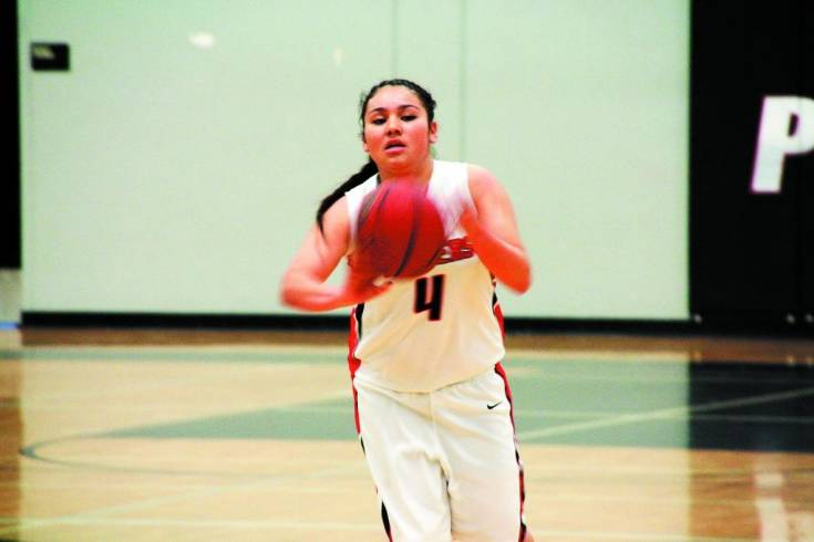 Freshman Abriana Ramirez pushes the ball up the floor during Pomona�s victory over Chatfield on Saturday.