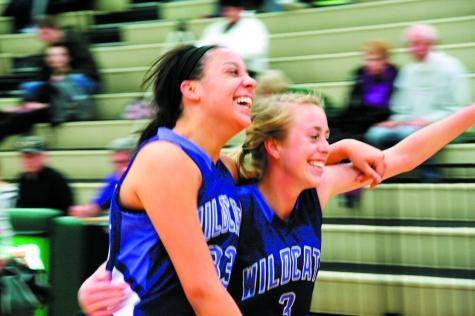 A pair of Wildcats run off the court after their dramatic 17-point comeback win at Bear Creek on Saturday.
