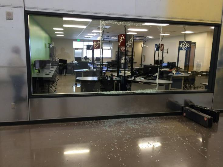 The photo shows the shattered glass and the damage vandals did inside the Englewood High School Science, Technology, Engineering and Math lab. The vandals struck in the early morning hours of Jan. 12 and did thousands of dollars in damage to the lab and to the band and choir rooms and the auditorium.