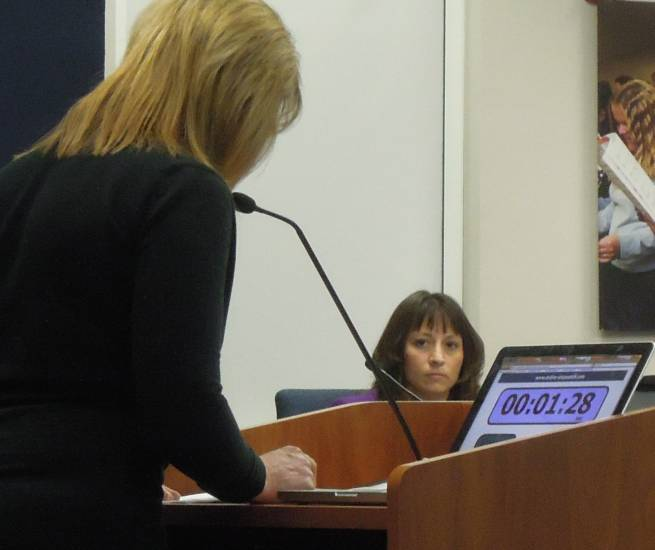 Superintendent Elizabeth Fagen listens as former school board candidate Julie Keim reads a statement critical of her and other district leaders during the Jan. 21 school board meeting. Photo by Jane Reuter
