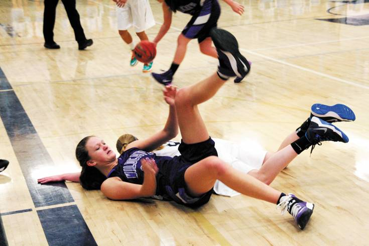 Arvada West sophomore Jessi Kenney gives her body up to try and make a play for her team during their meeting with Ralston Valley on Thursday.