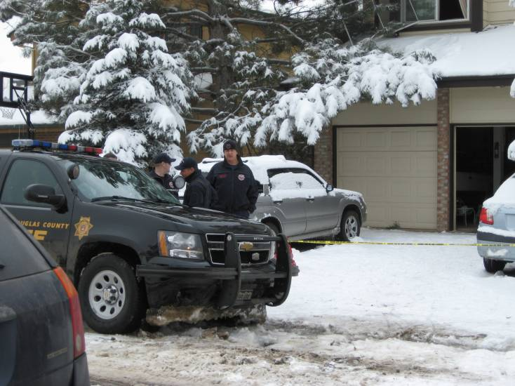 Douglas County Sheriff's Office investigators were on scene Saturday at the home where a shooting left two dead the previous night in Highlands Ranch.