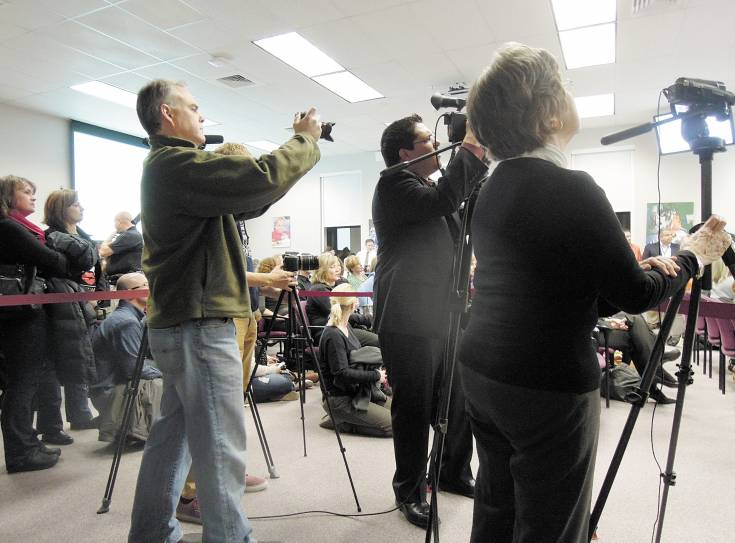 People stood and sat on the floor during a packed Jan. 21 school board meeting. The area reserved for media also was crowded with high school and community journalists, teachers' union and school district representatives and filmmakers.