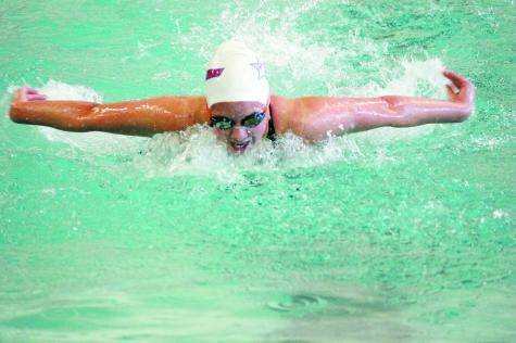 Heritage freshman Katherine Hartson powers toward a first-place finish in the 100-yard butterfly league championship during the Feb. 8 Continential League Swimming and Diving Meet at Heritage High School.
