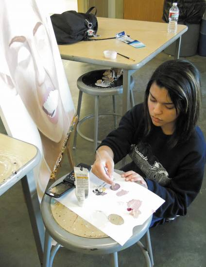 Pinnacle High School Senior Karina Yapor works on a portrait of Miley Cyrus. Yapor recently won the Gold Key award and a $20,000 college scholarship through the Scholastic Art Contest.