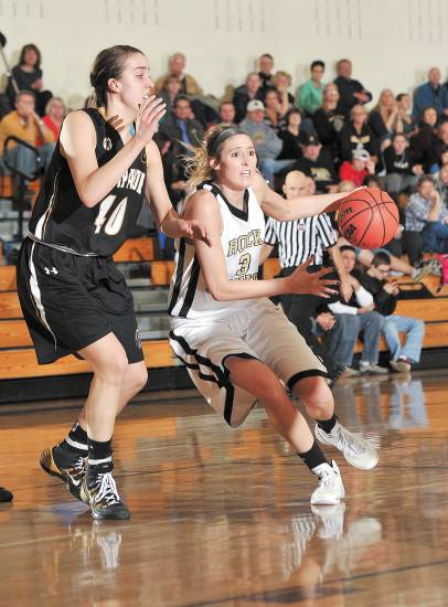 Rock Canyon�s Kendall Koslosky, right, looks to pass the ball to a teammate during the Jaguars� 60-44 win over Arapahoe Feb. 28 in the second round of the Class 5A state playoffs. Koslosky is guarded by Mikaela Moore of Arapahoe.