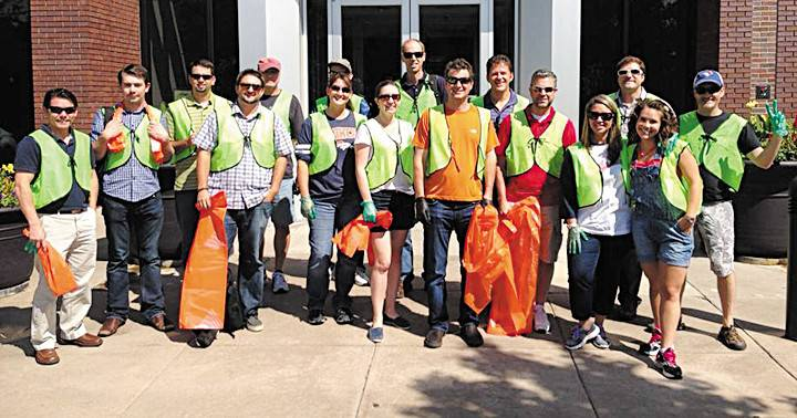 Trueffect employees prepare to do a street clean-up in Westminster last summer. The Westminster company was recently named to Forbes Magazine's list of America's Most Promising Companies in 2014, coming in at number 68 out of 100 companies.